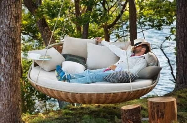 'Swingrest' - an outdoor hanging couch swing created by German company, Dedon. Product design.