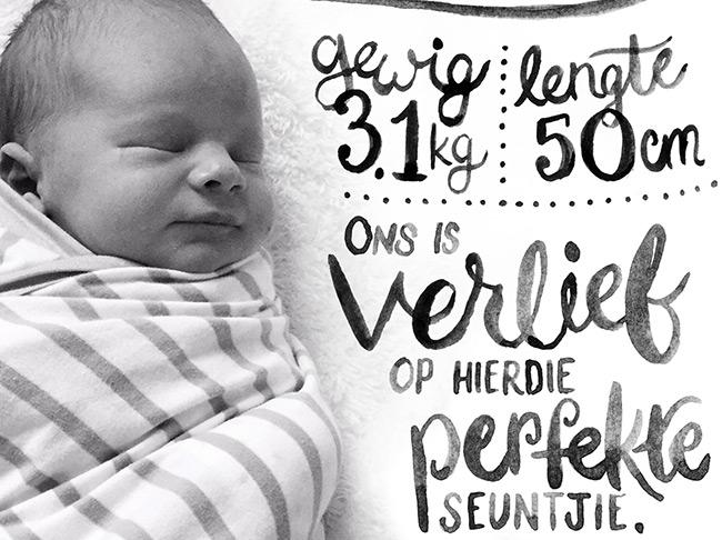 Hand lettered birth announcement